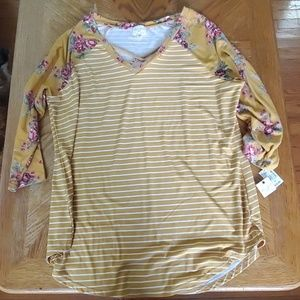 Brand new yellow top with floral sleeve design